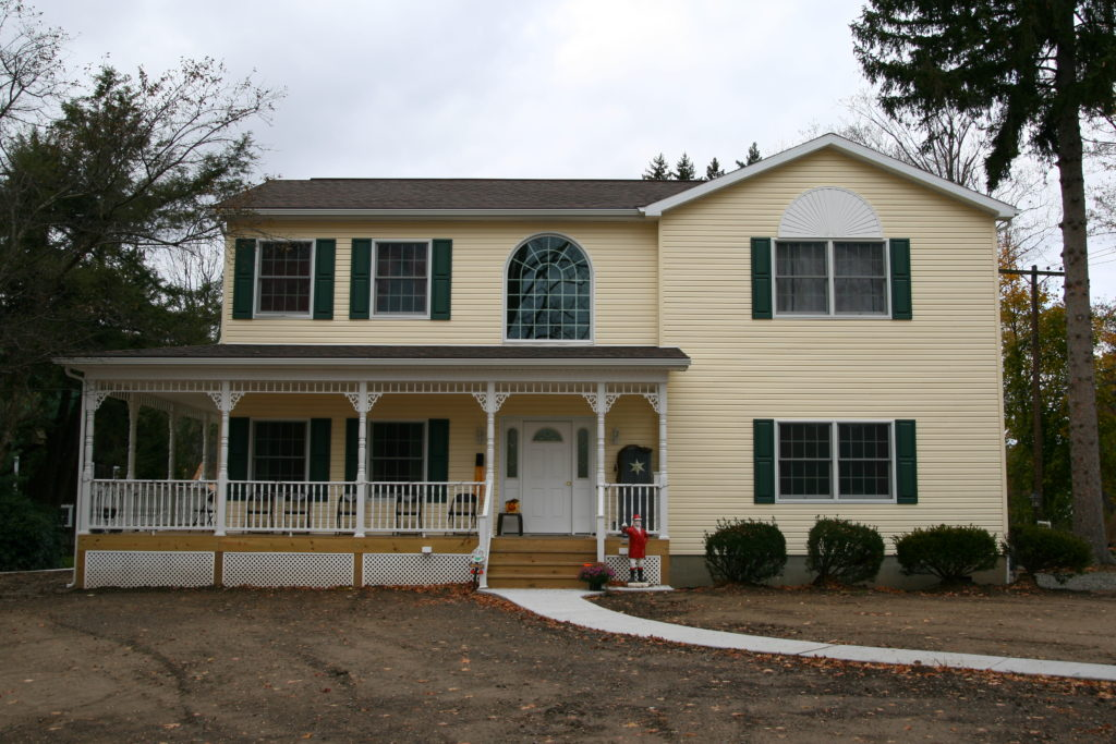 2-Story with wrap-around shed roof porch.
