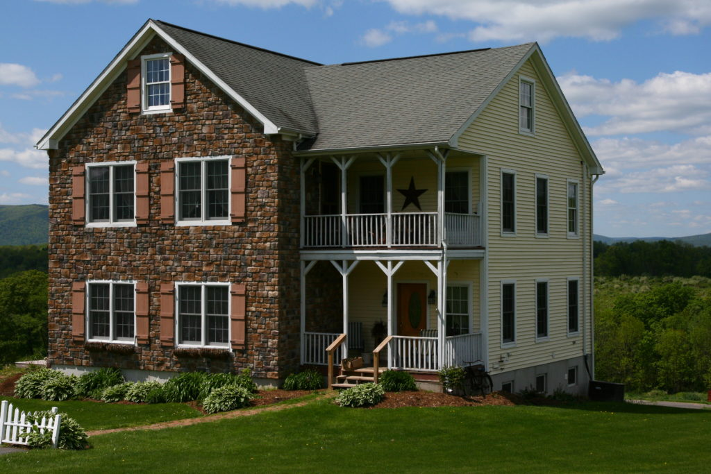 2-Story with stone front and custom porch.