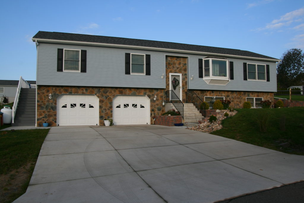 Raised Ranch with built-in two-car garage and stone front.