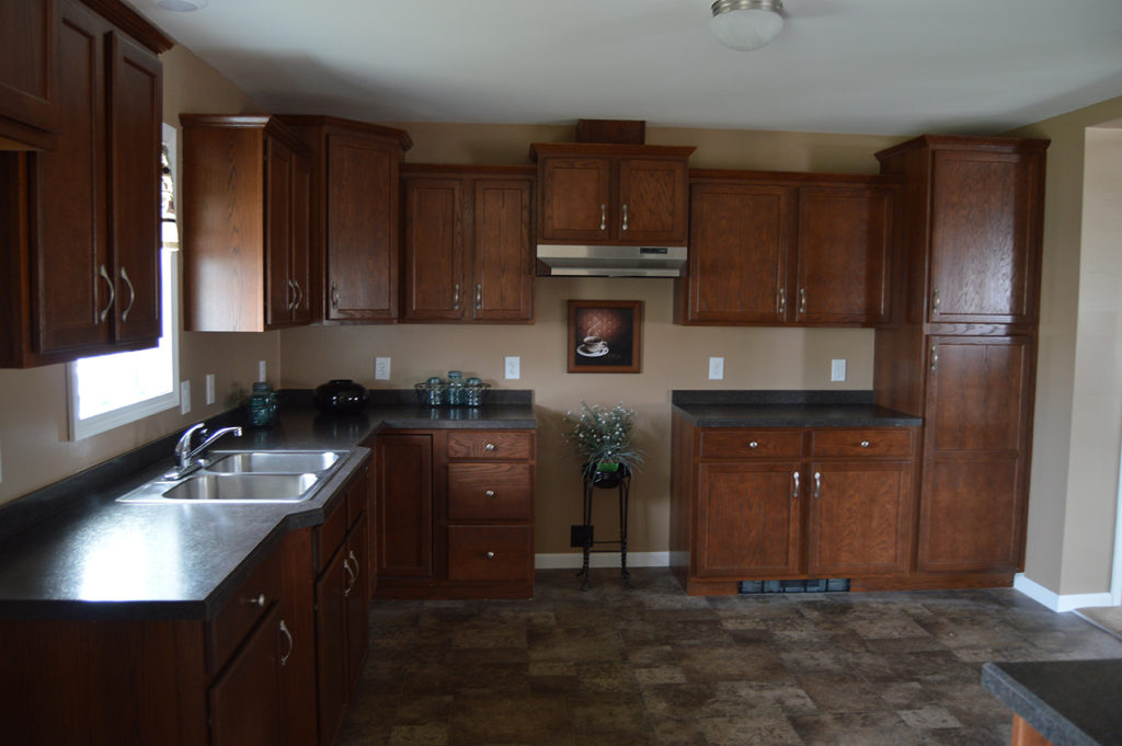 Kitchen w/ staggered cabinets
