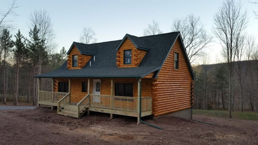 Cape Log Home with shed roof porch