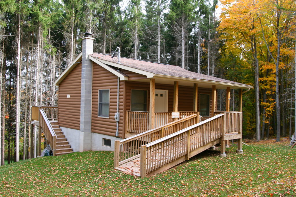 Vinyl Log Cabin with shed roof porch and chimney