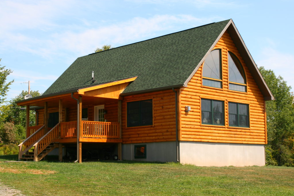 Chalet Log with shed roof porch.