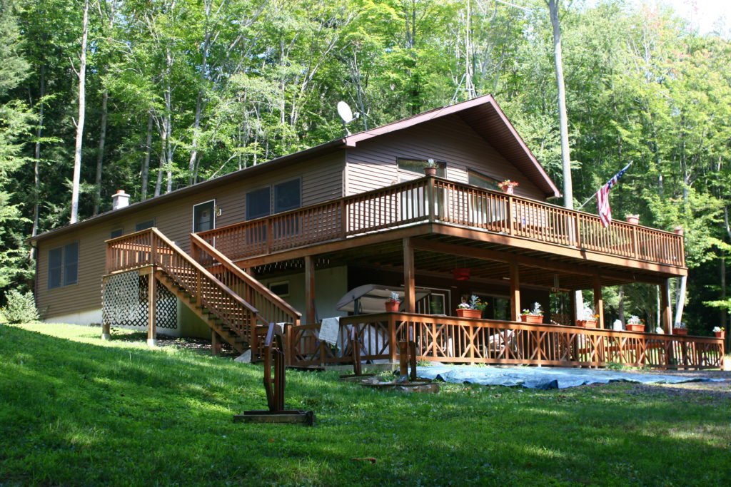Ranch Chalet with large pressure treated porch and walk-out basement area.